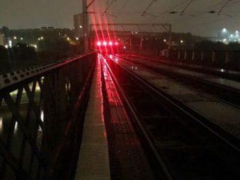 Railway bridge and rail tracks at night
