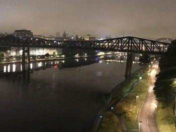 Railway bridge over a river at night